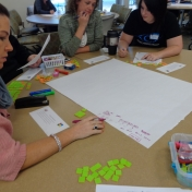 Participants use math manipulatives during a training.